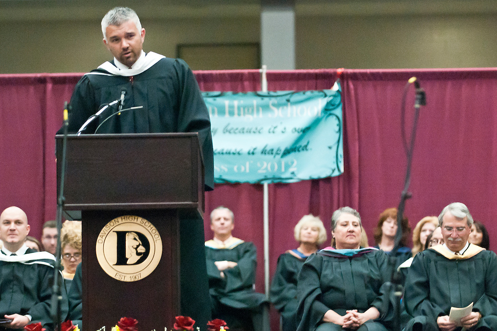 Lathan Goumas | MLive.com..Davison teacher T. J. Fischhaber speaks during the 2012 Davison High School commencement ceremony at the Perani Arena in Flint, Mich. on Monday June 11, 2012.