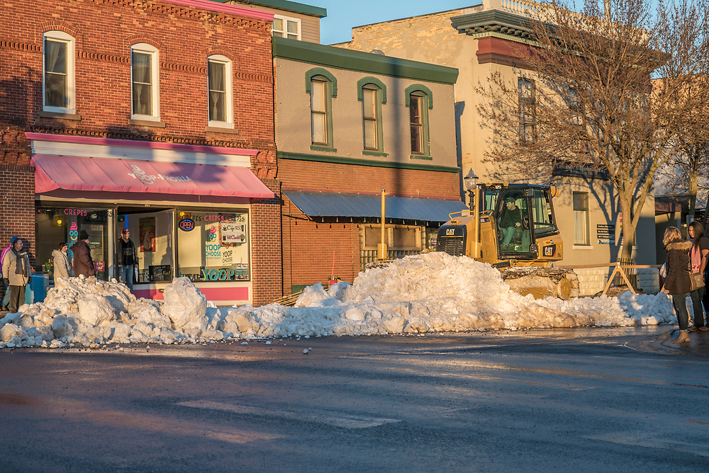 Heavy equipment prepares downtown Marquette Michigan for the UP 200 Sled Dog Championship race.