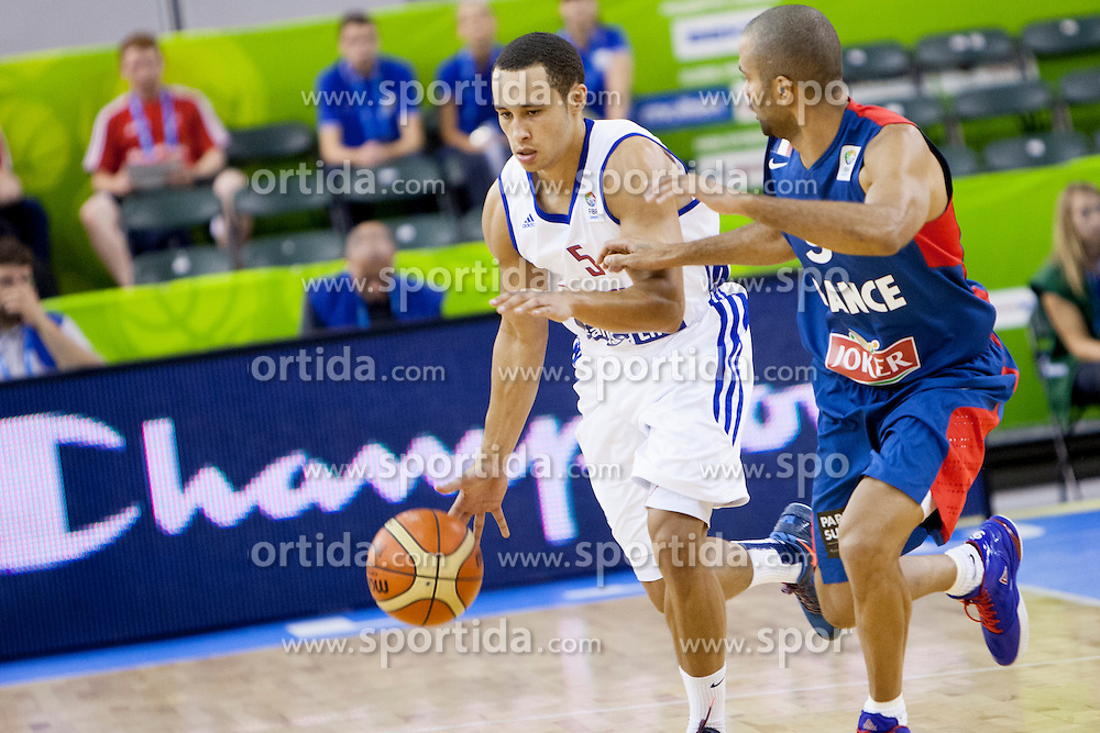 Andrew Lawrence #5 of Great Britain and Tony Parker #9 of France during basketball match between National teams of France and Great Britain at Day 2 of Eurobasket 2013 on September 5, 2013 in Tivoli Hall, Ljubljana, Slovenia. (Photo By Urban Urbanc / Sportida )