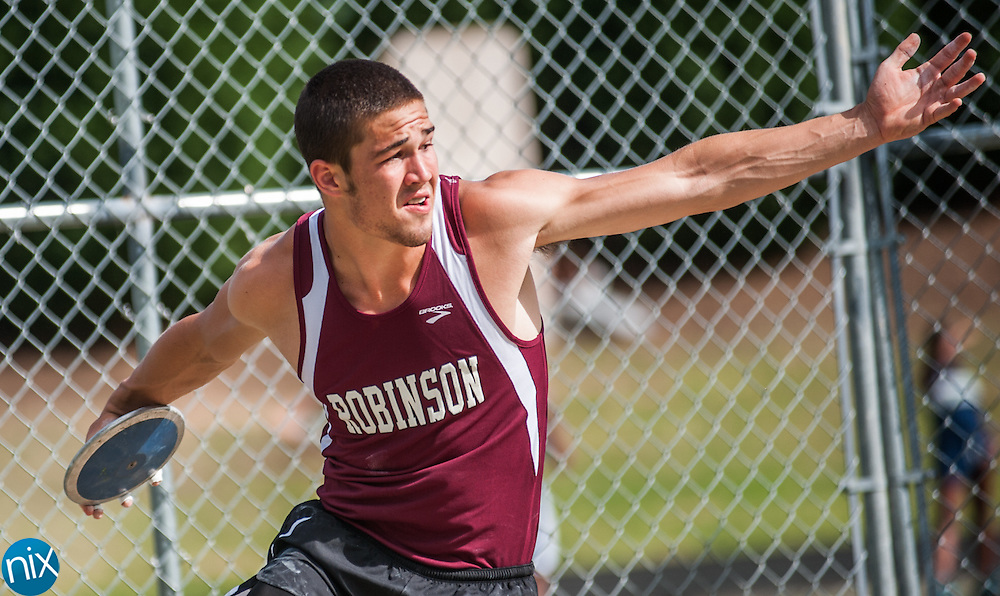 Jay M. Robinson's Jordan Raper competes in the discus throw during the South Piedmont Conference track and field championship at A.L. Brown High School Wednesday afternoon. Jay M. Robinson won the boys track meet and Robinson and A.L. Brown tied for first place in the girls meet.