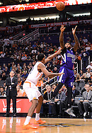 Nov 20, 2013; Phoenix, AZ, USA; Sacramento Kings center DeMarcus Cousins (15) puts up a shot against the Phoenix Suns forward Channing Frye (8) in the first half at US Airways Center. The Kings defeated the Suns 113-106. Mandatory Credit: Jennifer Stewart-USA TODAY Sports