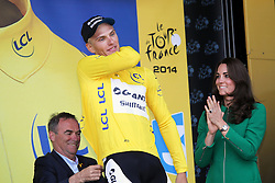 © Licensed to London News Pictures. HARROGATE, ENGLAND, UK. Saturday July 5th 2014. Tour de France Yorkshire Grand Depart. Stage 1 Leeds to Harrogate. The Duchess of Cambridge presents the yellow jersey to stage winner Marcel Kittel. Photo credit : Chris Etchells/LNP