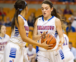 Morgantown forward Sydney Holloway (22) hands the ball off to Morgantown center Rachel Laskody (10) against Buckhannon Upshur during a first round game at the Charleston Civic Center.