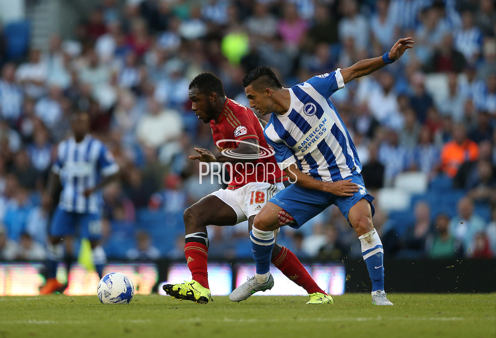 Brighton central midfielder, Beram Kayal and Nottingham Forest midfielder Michail Antonio during the Sky Bet Championship match between Brighton and Hove Albion and Nottingham Forest at the American Express Community Stadium, Brighton and Hove, England on 7 August 2015.