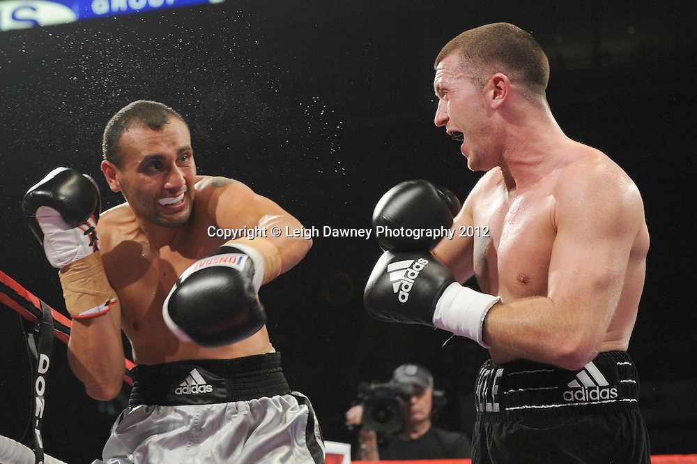 Scott Cardle defeats Karoly Lakatos in a Lightweight contest at the Motorpoint Arena, Sheffield, United Kingdom on the 7th July 2012. Promoted by Matchroom Sport. ©Leigh Dawney Photography 2012.