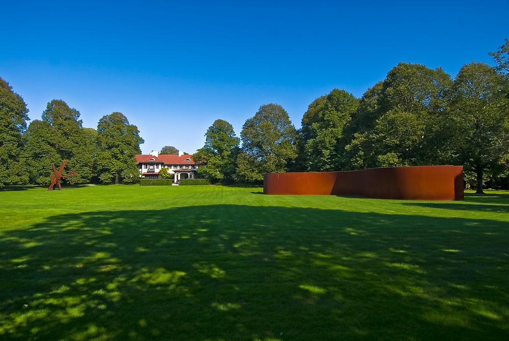"Richard Serra ""Torqued Ellipse"" standing on the lawn outside Leonard Riggio's Bridgehampton home."
