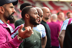 Raheem Sterling of Manchester City looks on as stewards hold them back from seeing there fans. - Mandatory by-line: Alex James/JMP - 13/05/2018 - FOOTBALL - St Mary's Stadium - Southampton, England - Southampton v Manchester City - Premier League
