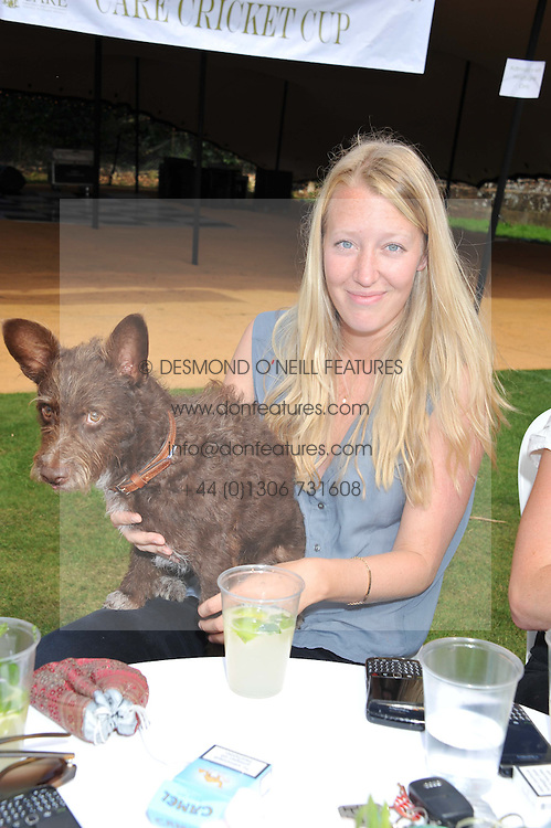 ALICE ROTHSCHILD and her dog Murphy at a cricket match to in aid of CARE - Corfu Animal Rescue Establishment held at Hawkley Cricket Club, Hawkley, Hampshire on 8th September 2012.