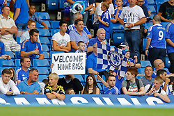 A fan with a banner for Chelsea's manager Jose Mourinho  - Photo mandatory by-line: Mitchell Gunn/JMP - Tel: Mobile: 07966 386802 18/08/2013 - SPORT - FOOTBALL - Stamford Bridge - London -  Chelsea v Hull City - Barclays Premier League