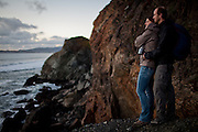 Hannah Hogan and Colin Groth watch the sunset off the coast of Marin County, Calif., December 12, 2012.
