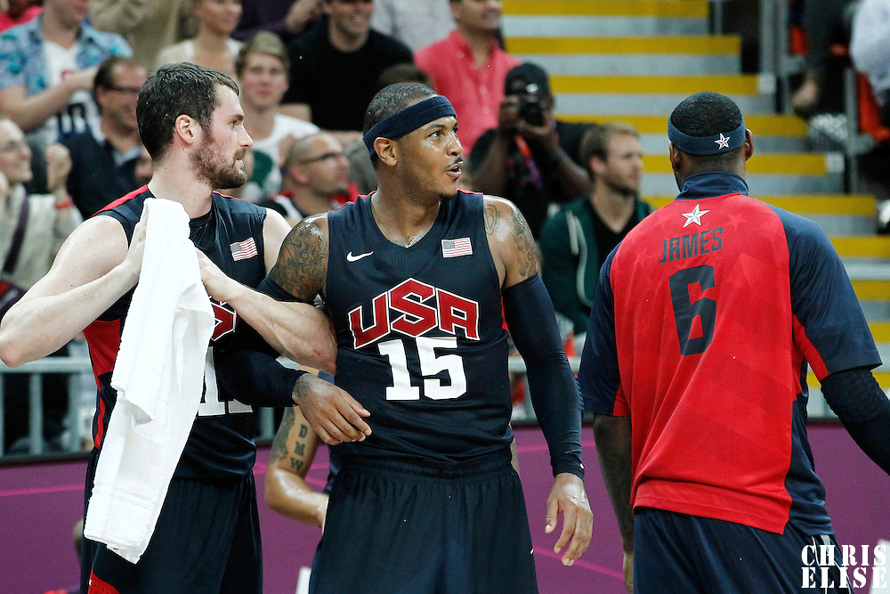 31 July 2012: USA Carmelo Anthony reacts next to Kevin Love during 110-63 Team USA victory over Team Tunisia, during the men's basketball preliminary, at the Basketball Arena, in London, Great Britain.