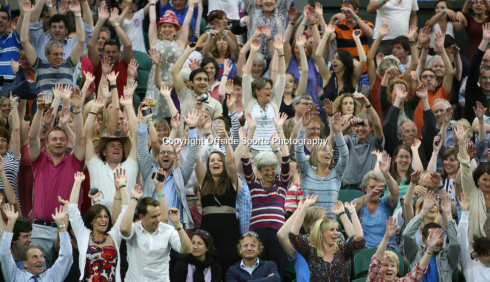 29/06/2012 - Wimbledon (Day 5) - Spectators enjoy themselves as they take part in a Mexican Wave - Photo: Simon Stacpoole / Offside.
