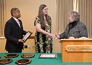 Ohio University President Roderick McDavis and Executive Vice President and Provost Pam Benoit congratulate Dr. Barbara Hahaffey during the Presidential Teacher Awards in the Multicultural Center on Sept. 23, 2014. Photo by Lauren Pond