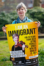 © Licensed to London News Pictures. 08/04/2015. LONDON, UK. Nicolette Moonen from Holland and a violinist taking part at 'I am an Immigrant' poster campaign launch in London on Wednesday, 8 April 2015. The posters feature images of 15 immigrants and will appear in 400 London tube stations and 550 national rail stations across the country. Photo credit : Tolga Akmen/LNP