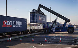 © Licensed to London News Pictures. 18/01/2017. London, UK. A container is unloaded from the first direct rail freight train from China as it arrives at Barking Rail Freight Terminal east of London. The new service set off from China on the 3rd of January this year. London is now the 15th European city to join what the Chinese government calls the New Silk Route. Photo credit: Peter Macdiarmid/LNP