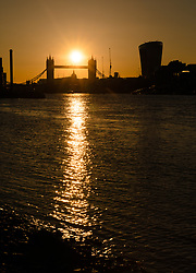 © Licensed to London News Pictures. 25/05/2017. LONDON, UK.  The sun sets on the River Thames behind Tower Bridge, St Paul's Cathedral and City of London skyscrapers after a day of hot and sunny weather in London. Photo credit: Vickie Flores/LNP