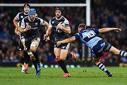 27th April 2019 , Principality Stadium , Cardiff, Wales ; Guinness pro 14's, Round 21, Cardiff Blues Vs Ospreys ; Dan Evans of Ospreys evades the tackle of Jarrod Evans of Cardiff Blues<br /> <br /> Credit :  Craig Thomas/Replay Images