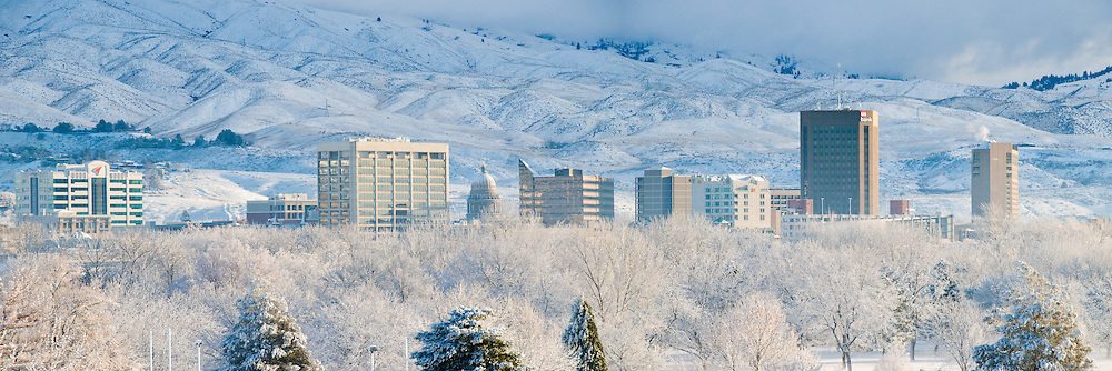 Idaho. Boise. Fresh winter snow with city skyline and foothills beyond.
