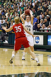 18 March 2011: Olivia Lett passes off when approached by Jordan Rettig during an NCAA Womens basketball game between the Washington University Bears and the Illinois Wesleyan Titans at Shirk Center in Bloomington Illinois.