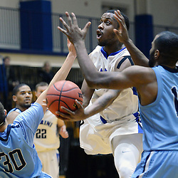 DAILY TIMES - TOM KELLY IV<br /> Cabrini's Aaron Walton-Moss (2) goes up for a layup past Immaculata's Joshua Smith (30) and Ron Melton (13) during the Immaculata at Cabrini men's basketball game on Wednesday, January 7, 2014.