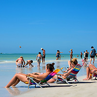 Sunbathers at Siesta Beach on Siesta Key in Sarasota, Florida<br />