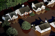 An Austell neighborhood near Atlanta is flooded up to the second floor of most homes.