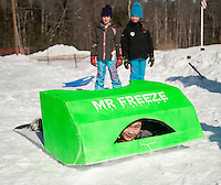 """Alex Richardson preps his sled """"Mr. Freeze"""" for the Gilford Parks and Recreation Cardboard Derby on Wednesday morning.  (Karen Bobotas/for the Laconia Daily Sun)"""