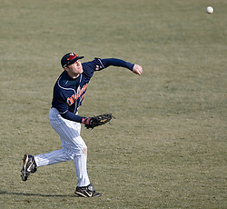 Virginia Cavaliers outfielder Tim Henry (6) throws the ball to the infield against GWU.  The Virginia Cavaliers Baseball Team defeated the George Washington University Colonials 15-2 to complete a sweep of the three game series on February 19, 2007 at Davenport Field, Charlottesville, VA.