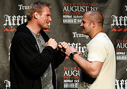 """June 3, 2009; New York, NY, USA; Fedor Emelianenko (r) and Josh Barnett (l) pose at the press conference announcing their fight at Affliction M-1 Global's """"Trilogy"""".  The two will meet on August 1, 2009 at the Honda Center in Anaheim, CA."""