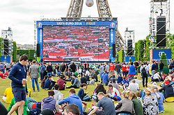 Fans settle in to watch Austria v Hungary on the big screens at the Paris Fanzone. Images from the UEFA EURO 2016, 14 June 2016 in Fan Zone. (c) Paul Roberts | Edinburgh Elite media. All Rights Reserved
