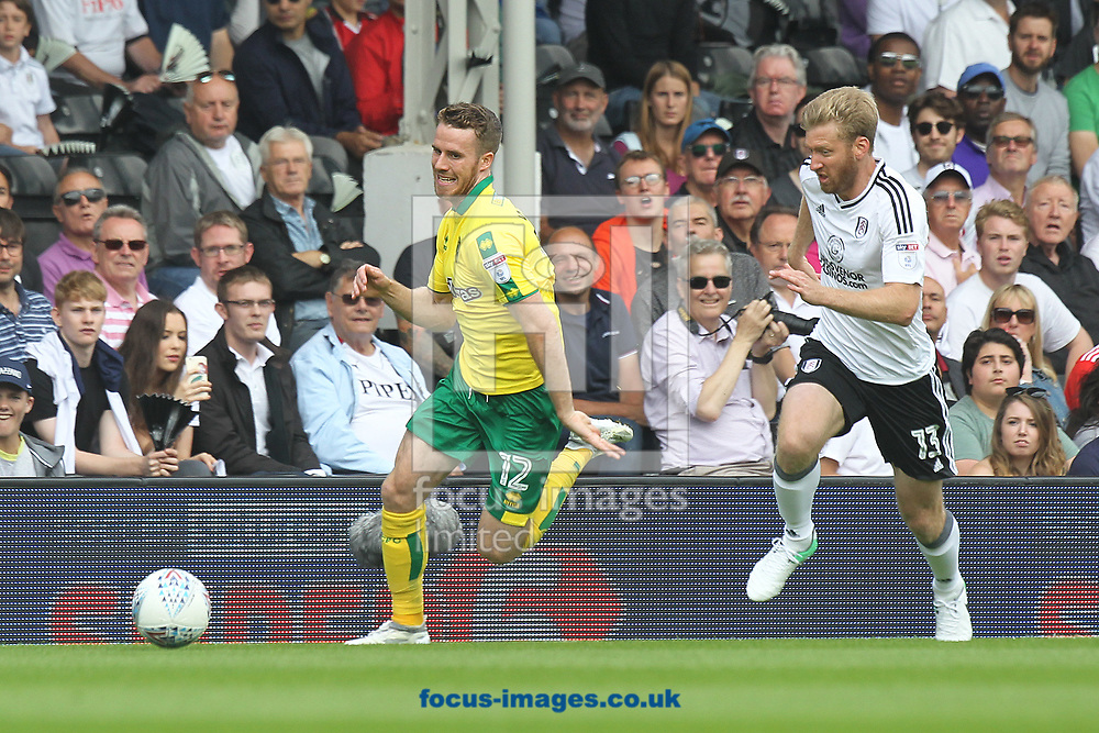 Marley Watkins of Norwich and Tim Ream of Fulham in action during the Sky Bet Championship match at Craven Cottage, London<br /> Picture by Paul Chesterton/Focus Images Ltd +44 7904 640267<br /> 05/08/2017