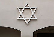 Star of David on the facade of the Pinkasova synagoga or Pinkas synagogue, built 1535 and named after the Krakow Rabbi Pinkas, grandson of Aharon Meshullam Horowitz, in the Jewish quarter or Josefov, Prague, Czech Republic. It is now administered by the Jewish Museum. The historic centre of Prague was declared a UNESCO World Heritage Site in 1992. Picture by Manuel Cohen