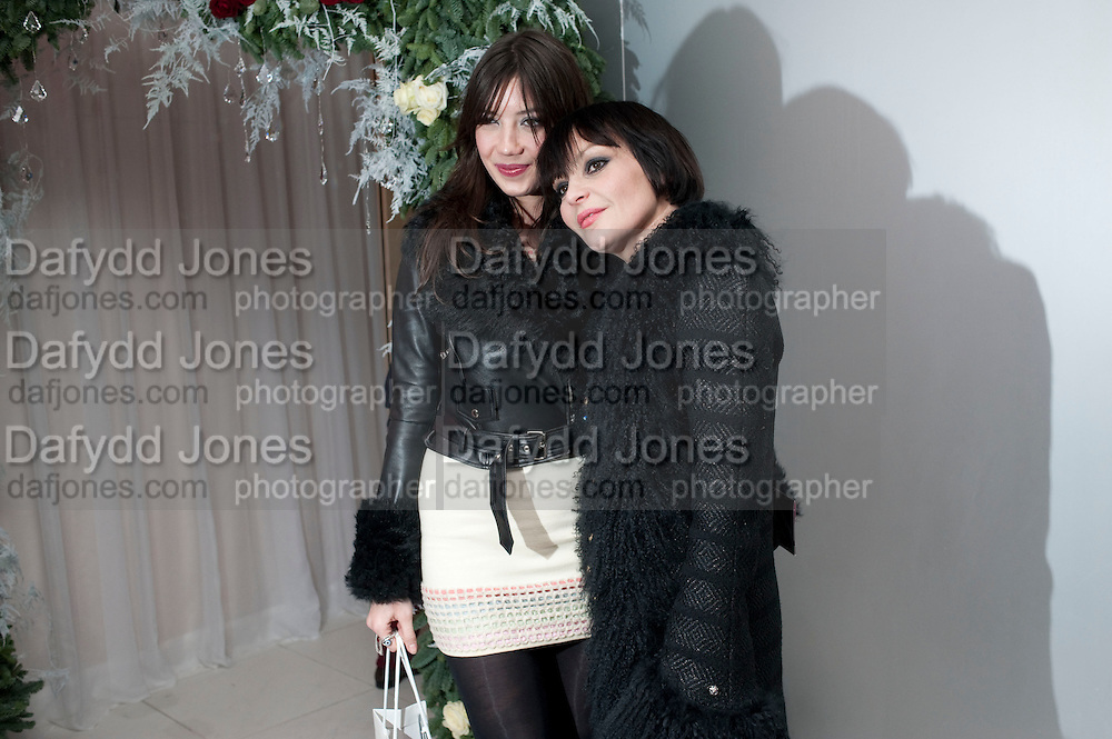 DAISY LOWE; PEARL LOWE, English National Ballet launches its Christmas season with a partyu before s performance of The Nutcracker at the Coliseum.  St. Martin's Lane Hotel.  London. 16 December 2009 *** Local Caption *** -DO NOT ARCHIVE-© Copyright Photograph by Dafydd Jones. 248 Clapham Rd. London SW9 0PZ. Tel 0207 820 0771. www.dafjones.com.<br /> DAISY LOWE; PEARL LOWE, English National Ballet launches its Christmas season with a partyu before s performance of The Nutcracker at the Coliseum.  St. Martin's Lane Hotel.  London. 16 December 2009