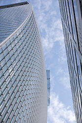 © Licensed to London News Pictures. 03/09/2013. London, UK. The 'Walky Talkie' building (L), also known as 20 Fenchurch Street, is seen in London today (03/09/2013). The building, still under construction, has hit headlines after it was found that, due to it's curved architecture, light reflected from the building at certain times of the day was melting cars and has the ability to cook eggs. Photo credit: Matt Cetti-Roberts/LNP
