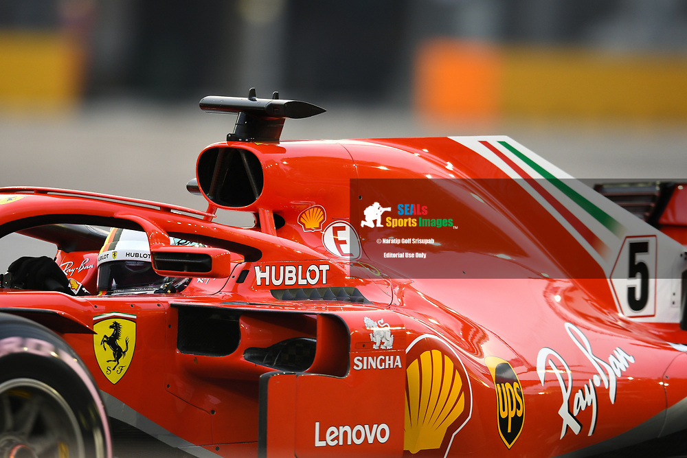 SINGAPORE - SEPTEMBER 15: Sebastian Vettel (5) of Scuderia Ferrari during FP3 at the F1 Singapore Airlines - Singapore Grand Prix 2018, Marina Bay Street Circuit, Singapore on September 15, 2018. <br /> .<br /> .<br /> .<br /> (Photo by: Naratip Golf Srisupab/SEALs Sports Images)<br /> .<br /> Any image use must include a mandatory credit line adjacent to the content which should read: Naratip Golf Srisupab/SEALs Sports Images