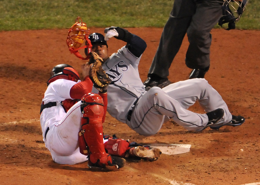 (Boston, MA - October 13, 2008) - The Tampa Bay Rays crush the Boston Red Sox 9-1 at Fenway Park in Game 3 of the ALCS. Carl Crawford dives into Jason Varitek trying to dislodge the ball and score on a sacrifice fly in the seventh...Photo by Will Nunnally / Boston Red Sox