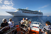 The Rhapsody of the Seas anchoring at Kona. Passengers going ashore aboard tender boats.