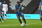 Wycombe Wanderers midfielder (on loan from AFC Bournemouth) Nnamdi Ofoborh (28)  sprints forward with the ball during the EFL Trophy match between Milton Keynes Dons and Wycombe Wanderers at stadium:mk, Milton Keynes, England on 12 November 2019.