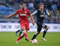 Fussball 2. Bundesliga:  Saison   2012/2013,    4. Spieltag  TSV 1860 Muenchen - MSV Duisburg    31.08.2012 Tanju Oeztuerk (li, MSV Duisburg) gegen Benjamin Lauth (1860 Muenchen)