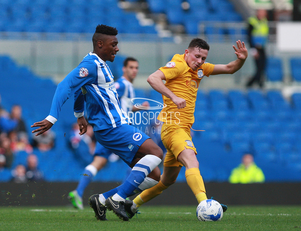 Preston North End midfielder Alan Browne and Brighton central midfielder Rohan Ince battle for possession during the Sky Bet Championship match between Brighton and Hove Albion and Preston North End at the American Express Community Stadium, Brighton and Hove, England on 24 October 2015. Photo by Bennett Dean.