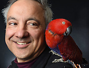 Photo by Mara Lavitt -- Special to the Hartford Courant<br /> March 21, 2015, Middletown<br /> The eighth FeatherFest was held in Middletown by the Connecticut Parrot Society providing visitors with education about parrots and other birds. Peter Lombardo of Rocky Hill with his eclectus parrot named Ava. Lombardo says about Ava, &quot;She talks. She's a character. She laughs. We take her out in a cat carrier for presentations. She was at UConn last week for a college level presentation. They [parrots] are still wild, they're not domesticated.&quot;