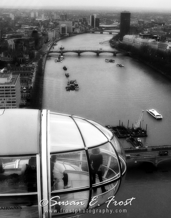The London Eye.  Designed by David Marks and Julia Barfield. Unlike the the traditional Ferris wheel,  the 32 capsules are fixed outside the rim and rotate mechanically.  Largest observation wheel in the world at 135 metres London, England.