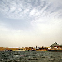 Moon Lake is the natural oasis in Tengger Desert.<br />Tengeer Deser covers an area of 36,700 square Kilometers, criss-cross by sand hills, basins, hills, and flat lands, 1200 to 1400 meters above sea level. There are more than 400 lakes, the Majority of which are fresh. It is an ideal place for desert adventures.<br /> Photo: Bernardo De Niz