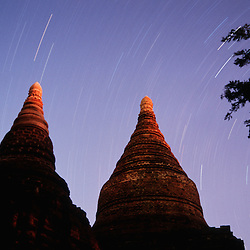 The ancient temples of Bagan illuminated by moon and starlight in Myanmar.