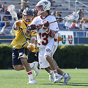 Denver Attacker Zach Miller (33) perpares to attack the net as Drexel Midfielder Jordan Klunder (7) defends in the second half of The NCAA Division I Men's Lacrosse Tournament game between the No. 5 seed Denver and No. 12 ranked Drexel Sunday, May. 18, 2014 at Delaware Stadium in Newark, DEL