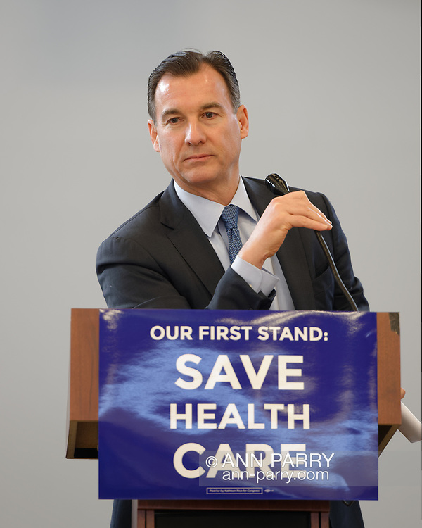 "Westbury, New York, USA. January 15, 2017. Rep. THOMAS SUOZZI (Democrat - 3rd Congressional District) speaks at the ""Our First Stand"" Rally against Republicans repealing the Affordable Care Act, ACA, taking millions of people off health insurance, making massive cuts to Medicaid, and defunding Planned Parenthood. Hosts were Suozzi and Rep. K. Rice (Democrat - 4th Congressional District)."