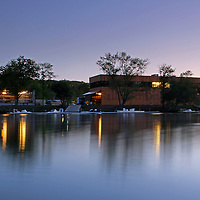 The architecture photography image of the aesthetics and modern Community Rowing boathouse landmark on the banks of the Charles River in Brighton, Massachusetts just outside of Boston  was taken in May 2014 on a beautiful night at twilight, only minutes after sunset. Twilight provides amazing opportunities for photographers and provides the artist with unique lighting that makes for exceptional skyline and cityscape photography pictures.  <br />