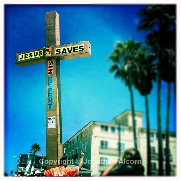 Jesus Saves sign made of cardboard on Venice Boardwalk