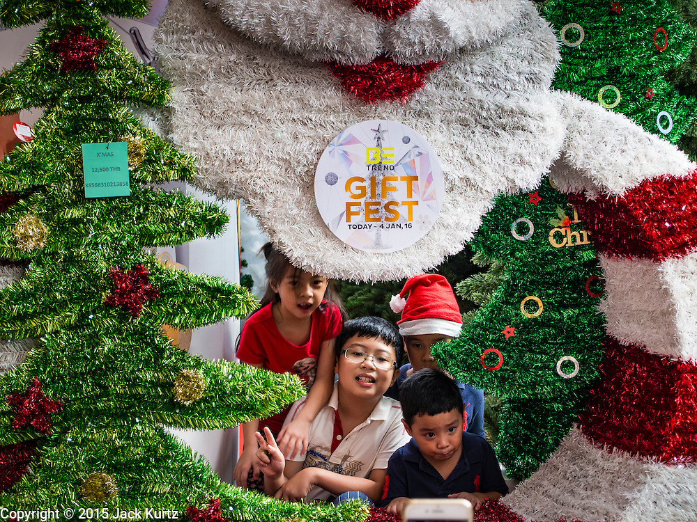 12 DECEMBER 2015 - BANGKOK, THAILAND: Children play in a Christmas display at EmQuarter, a new upscale shopping mall in Bangkok across Sukhumvit Road from Emporium, another Bangkok mall. Christmas in Thailand is a popular commercial / secular holiday.      PHOTO BY JACK KURTZ