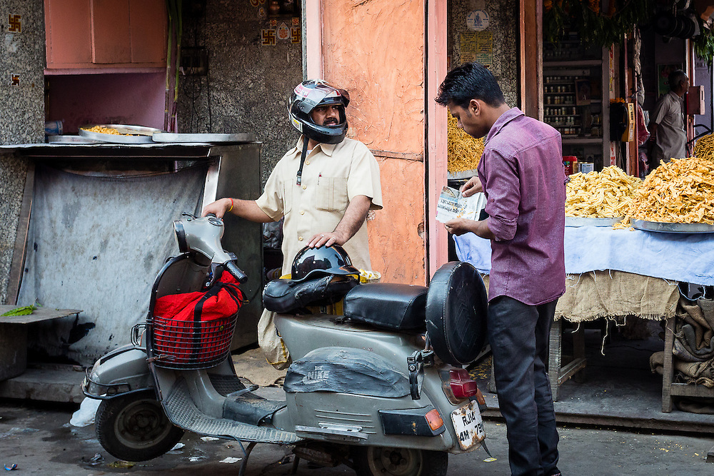 A typical street scene with two men talking in the Pink City.